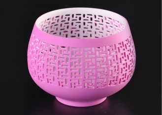 China pink hollow ceramic porcelain candle holders wholesale candlestick holders supplier